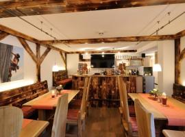 Sala del comedor de Ferienparadies Alpenglühn en Baviera, Alemania